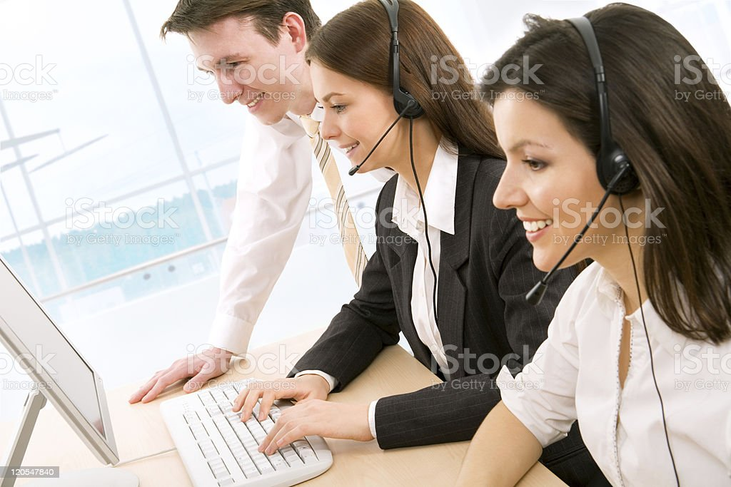 Two women phone operators one being trained stock photo