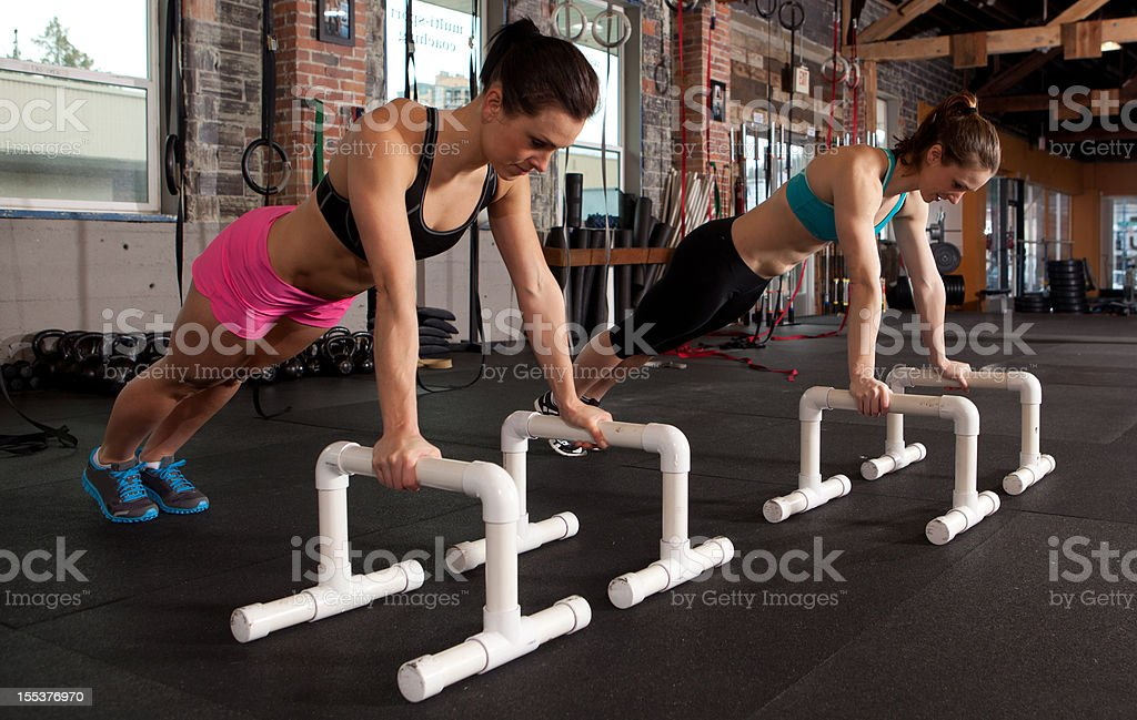 Two women planking royalty-free stock photo