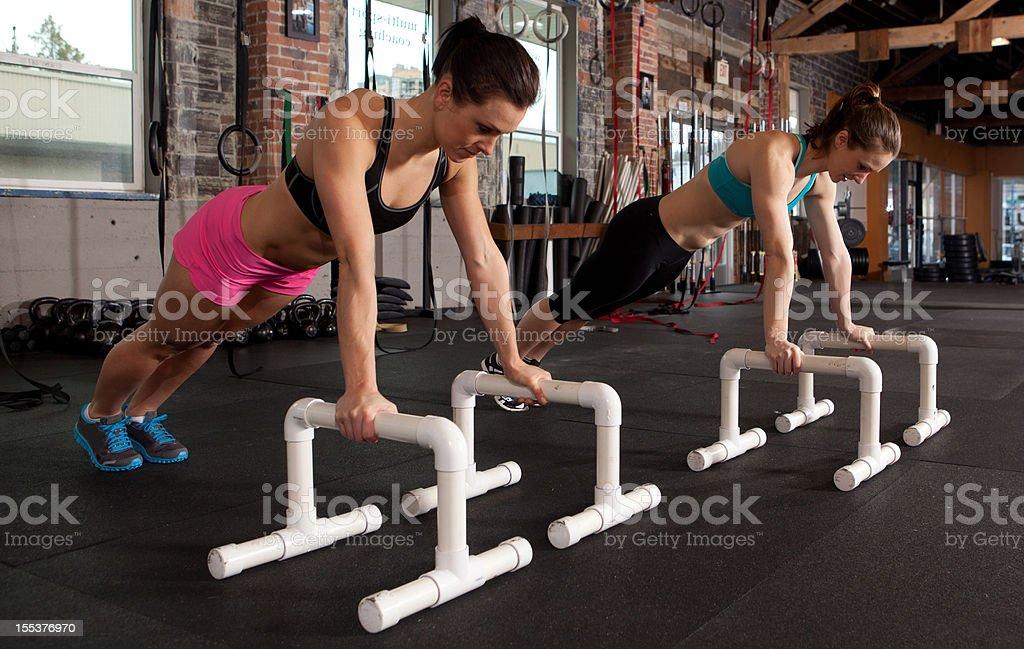 Two women planking stock photo