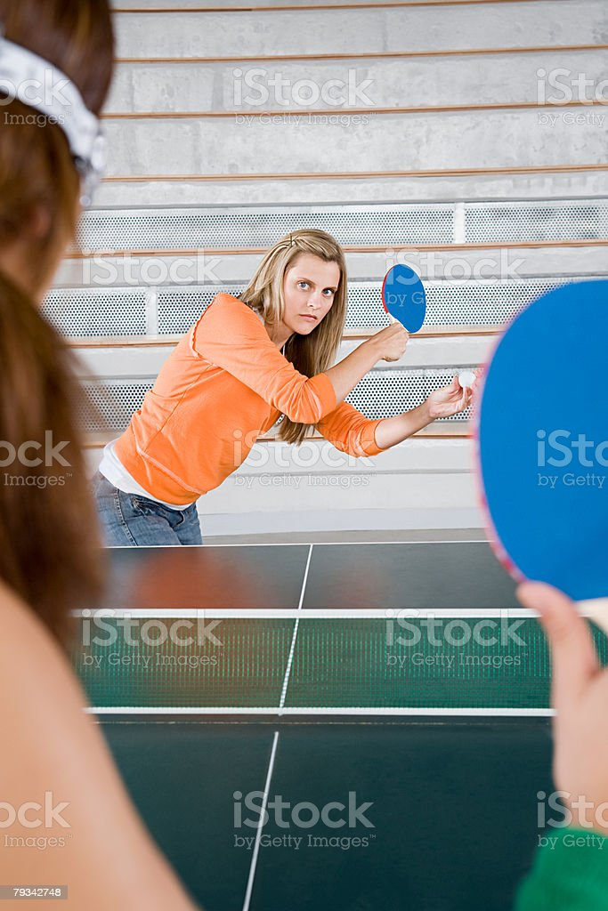 Two women playing table tennis stock photo