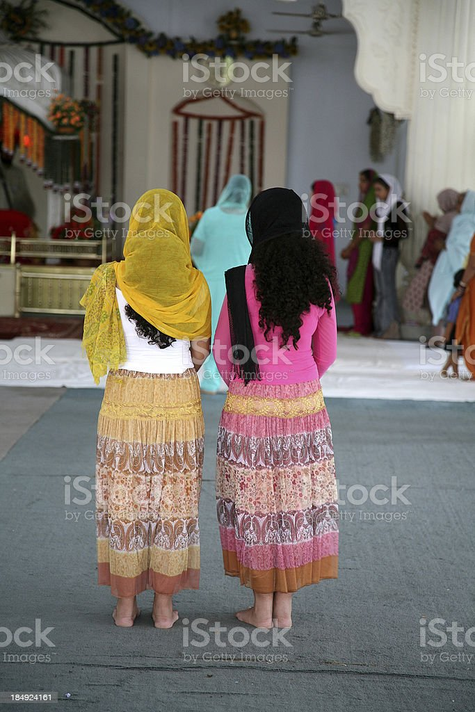 Two women praying in a Sikh temple royalty-free stock photo