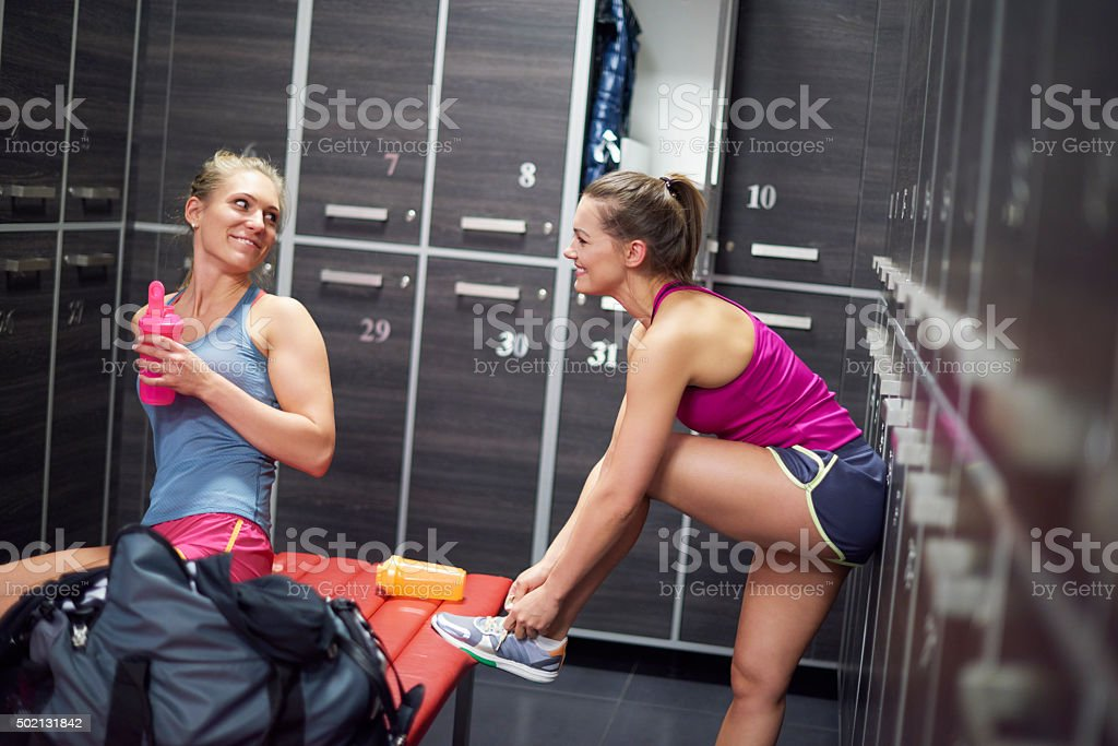 Two women preparing for the training at the gym stock photo