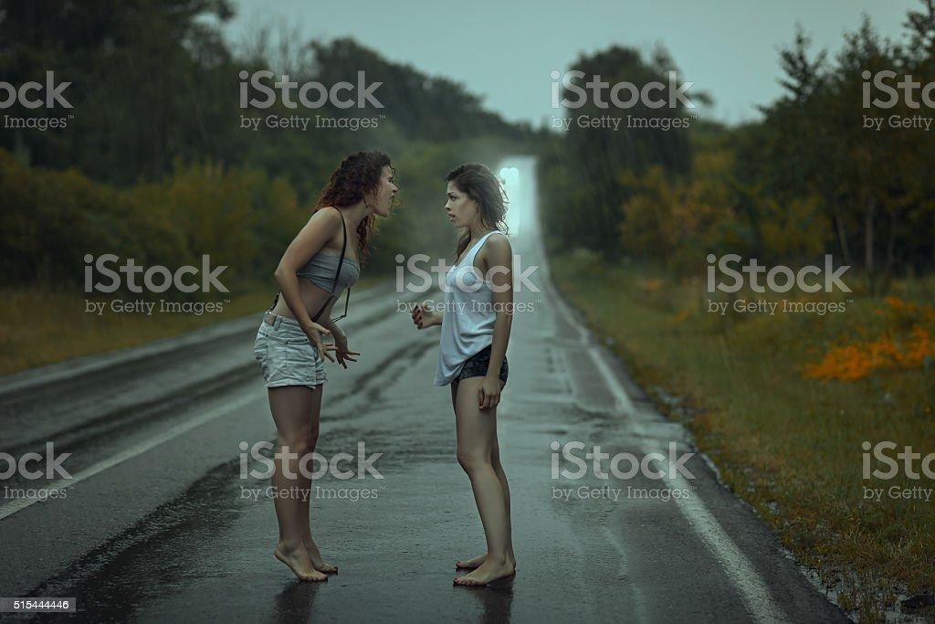 Two women quarrel. stock photo
