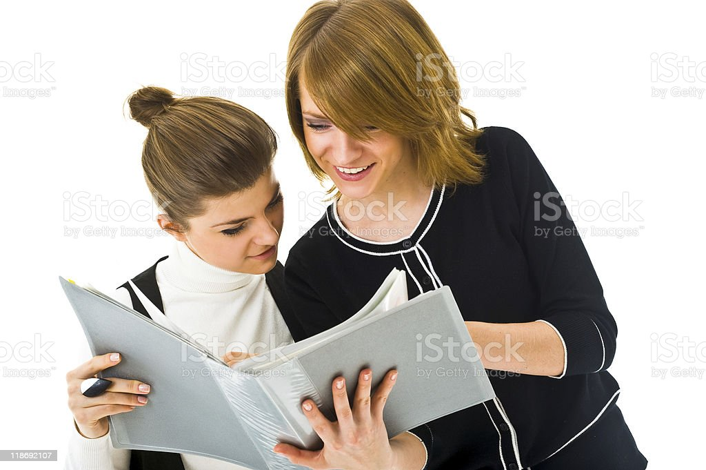 Two women reading together stock photo