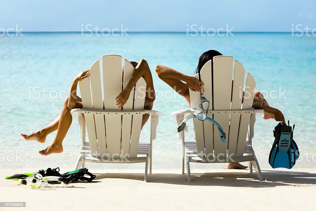 two women relaxing after snorkeling royalty-free stock photo