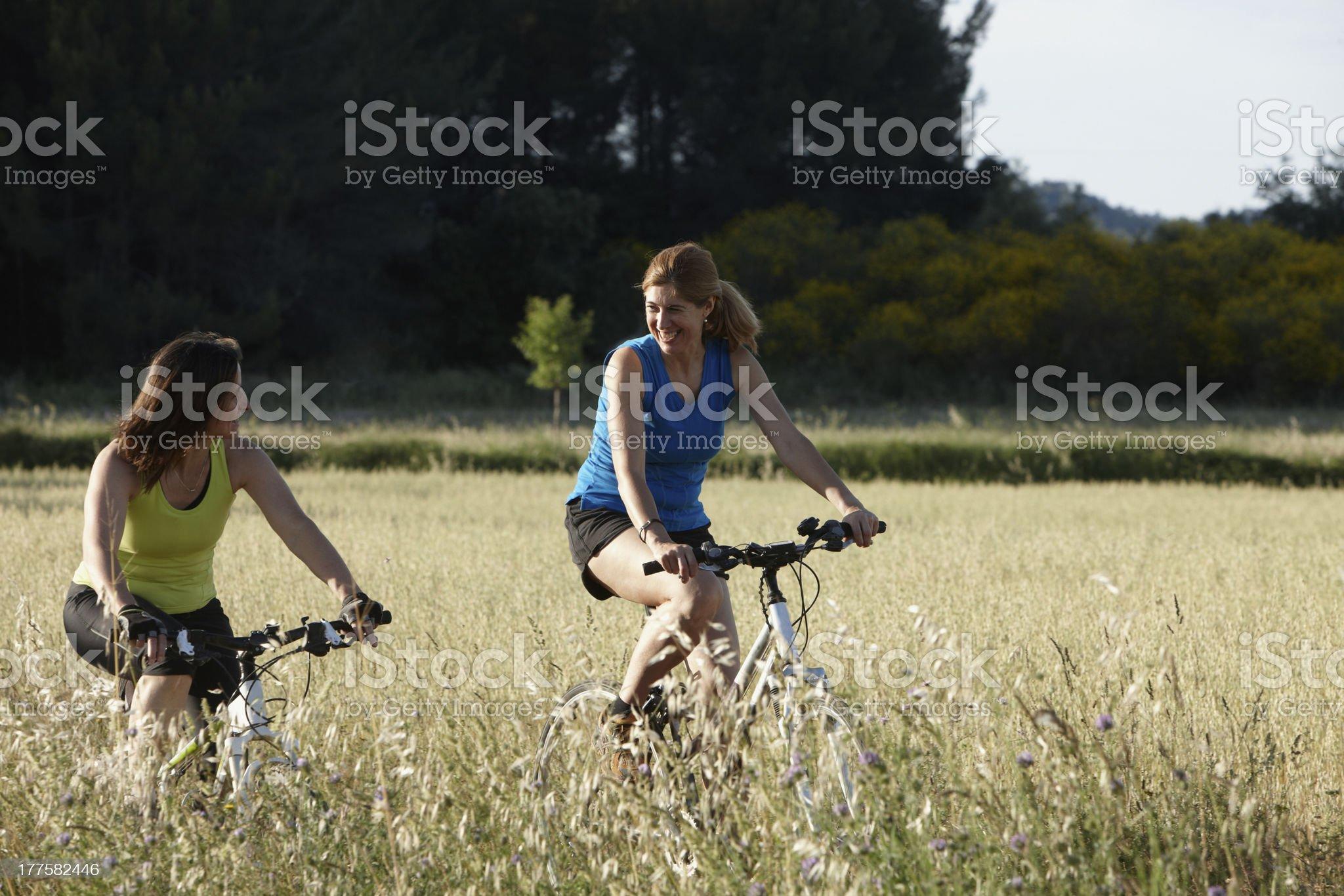 Two women riding mountain bike royalty-free stock photo