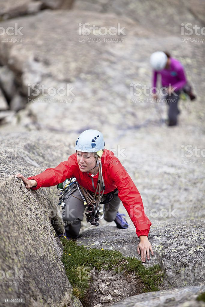 Two women rock climbing in Colorado royalty-free stock photo