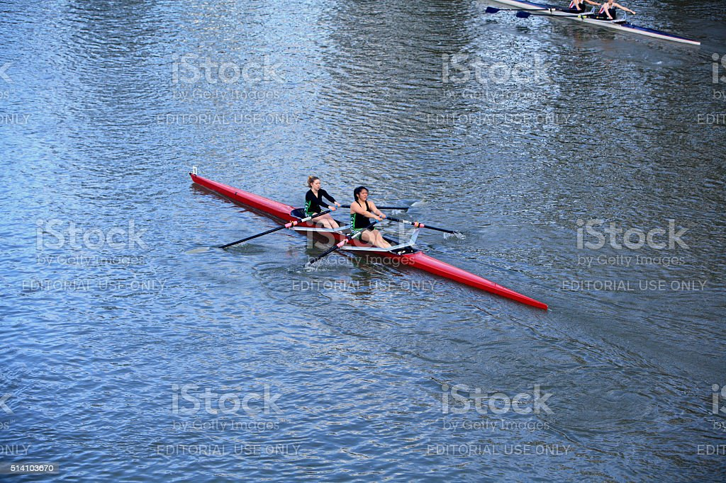 Two Women Rowing Competively stock photo