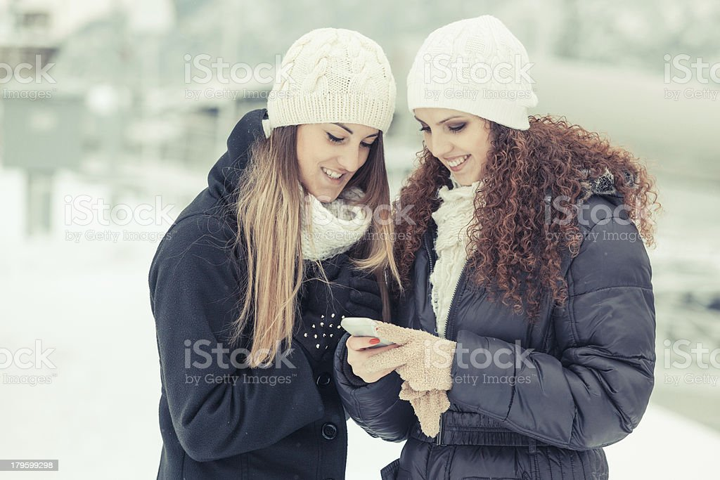 Two Women Sending a Message royalty-free stock photo