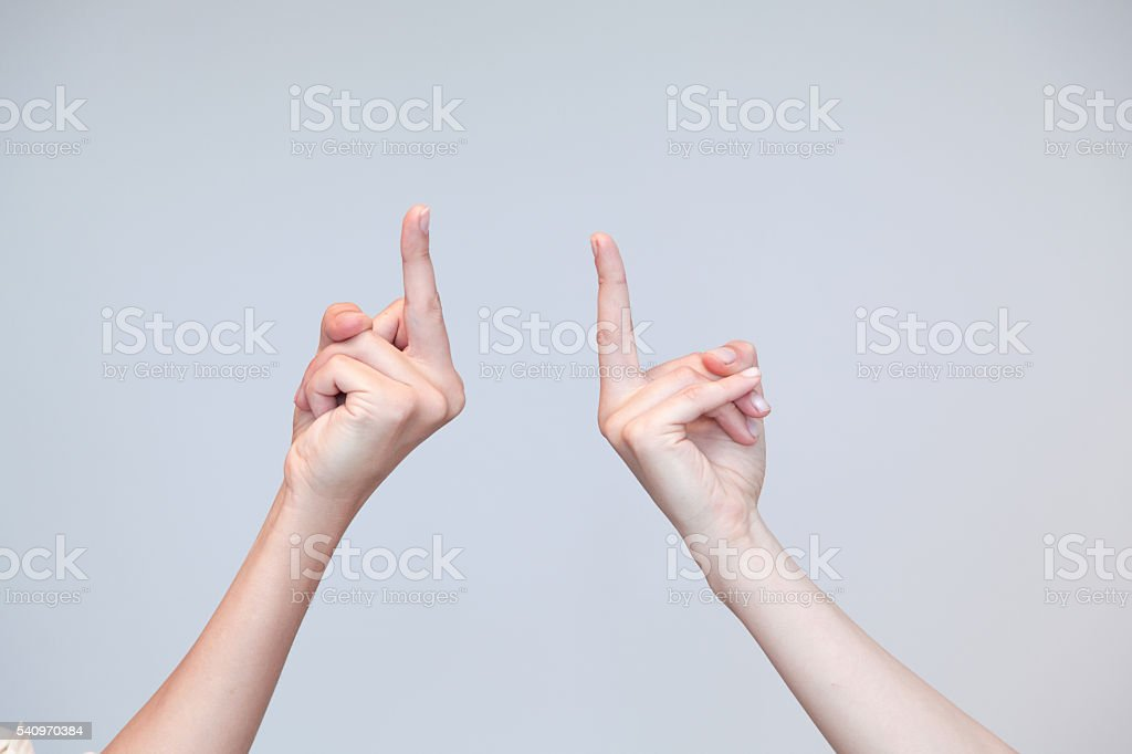 Two women showing middle finger each other stock photo