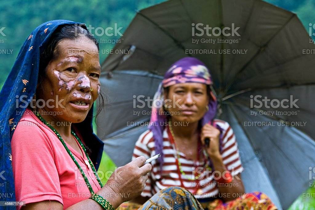 Two women sit on the trail. royalty-free stock photo