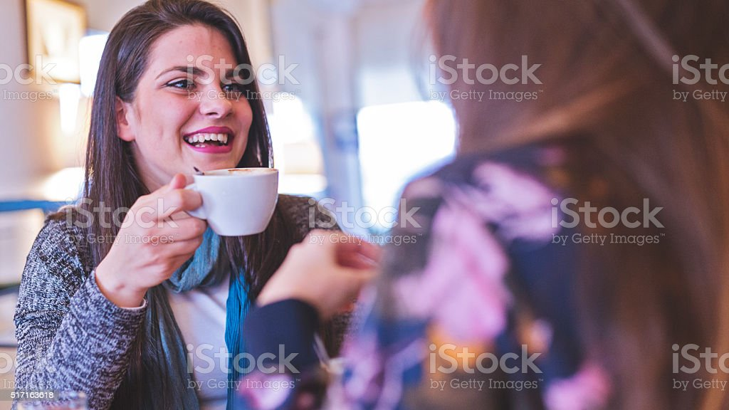 Two women sitting in cafe stock photo