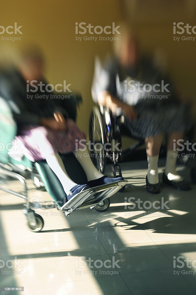 Two Women Sitting in Wheelchairs royalty-free stock photo