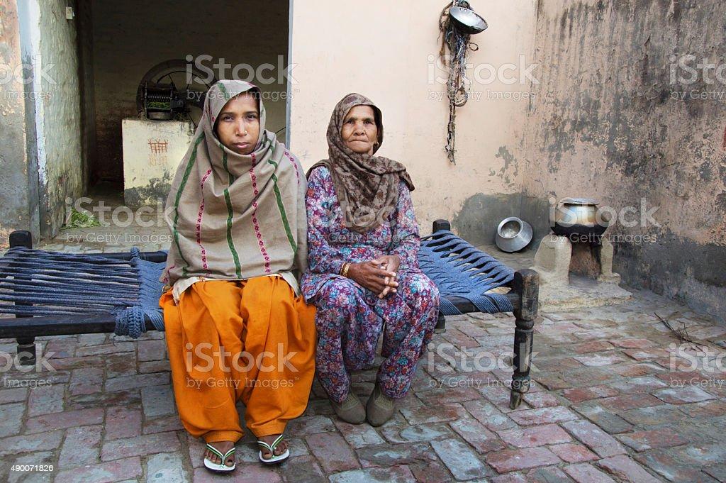 Two Women Sitting Portrait stock photo