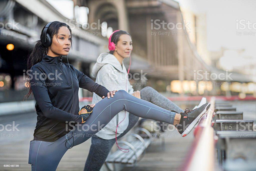 Two women taking a break from running session stock photo