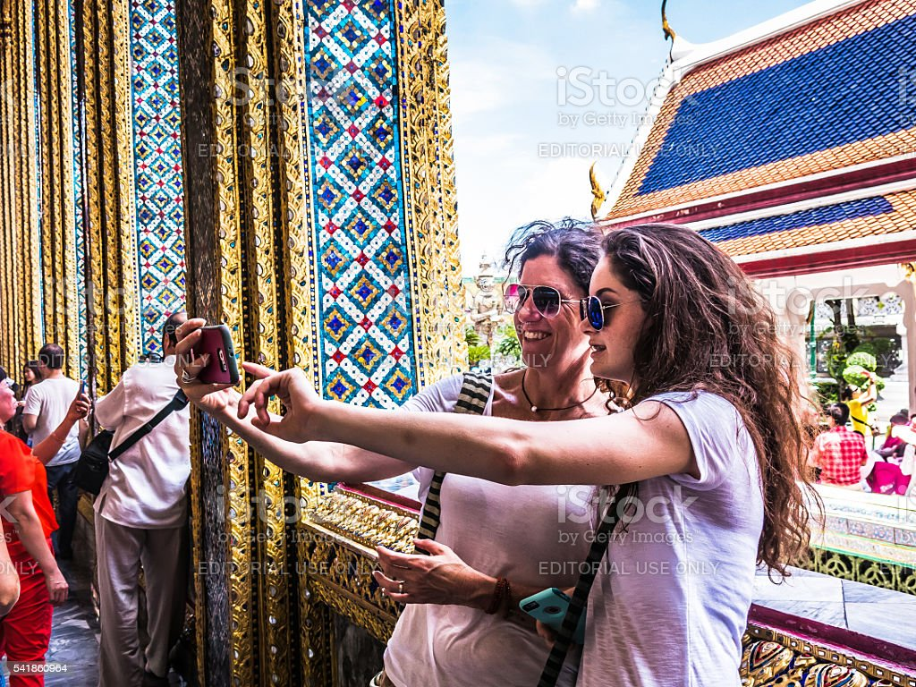 Two Women taking Selfie Photograph Bangkok stock photo