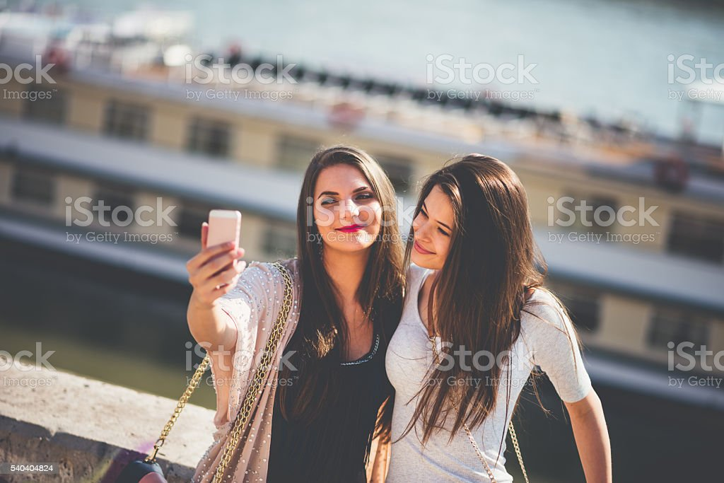 two women taking slefie in the Budapest stock photo