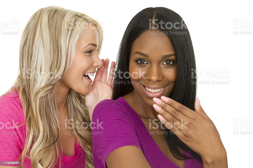 two women telling secrets royalty-free stock photo