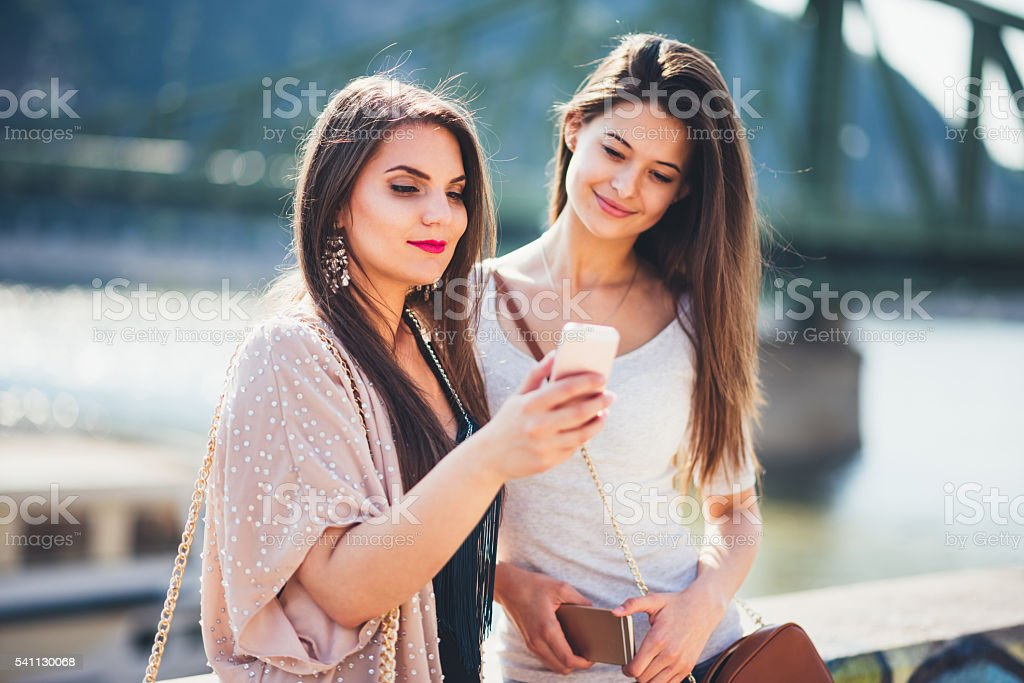 two women using phone in the Budapest stock photo