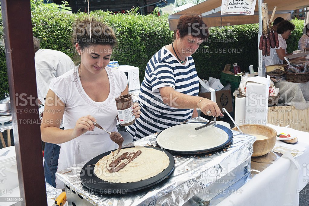 Two women vendors prepare crepes at Rougemont Brocante stock photo