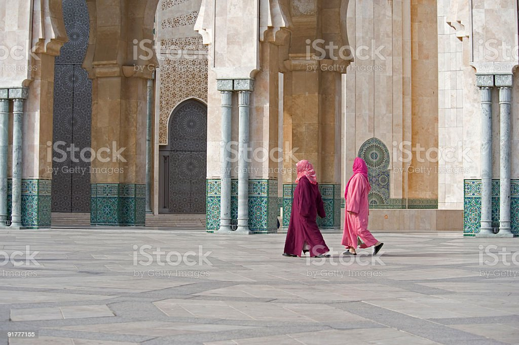 Two women walk in Hasan II Mosque in Casablanca, Morocco royalty-free stock photo