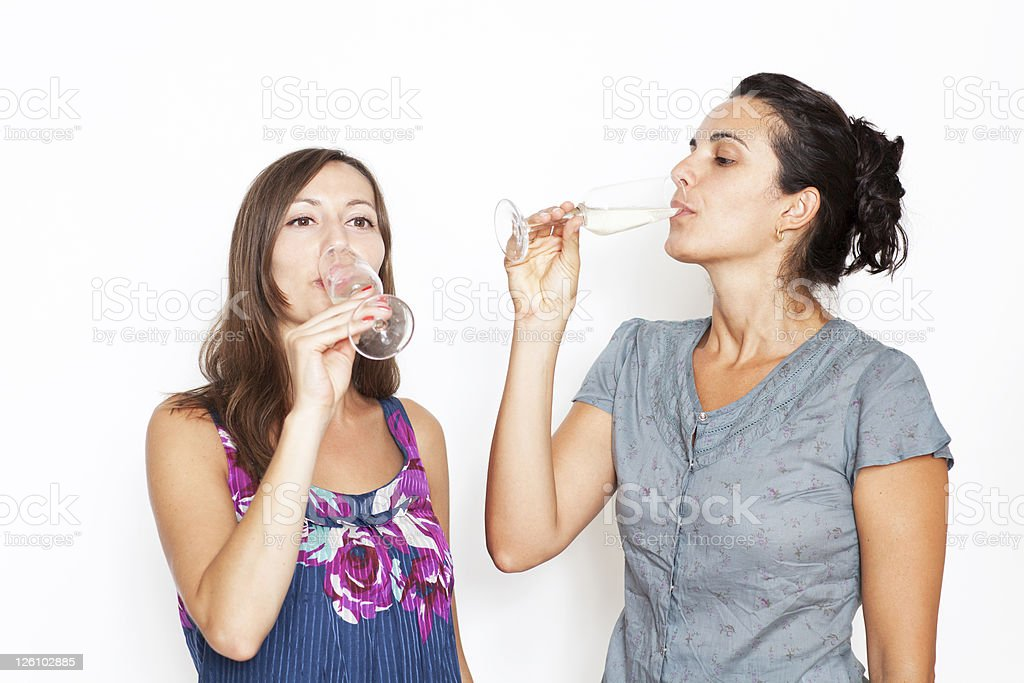 Two women with champagne royalty-free stock photo