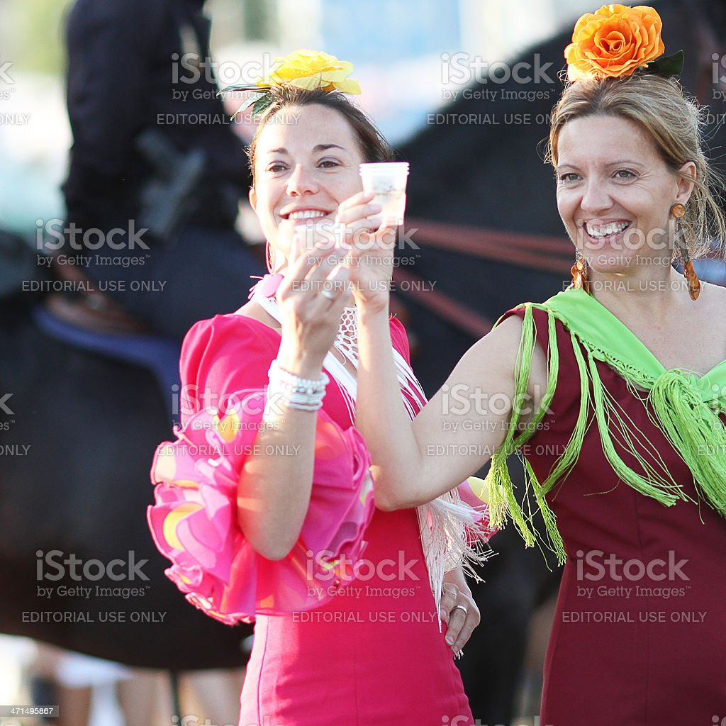 Two women with flamenco dresses during the April Fair stock photo
