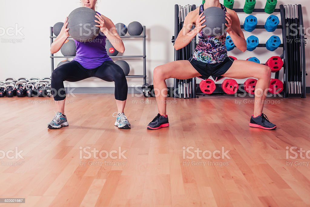 Two women with medicine balls stock photo