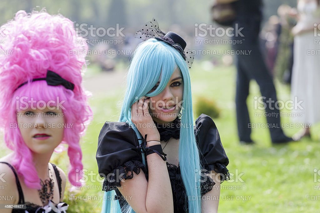 Two women with pink and blue wigs at Fantasy Fair royalty-free stock photo