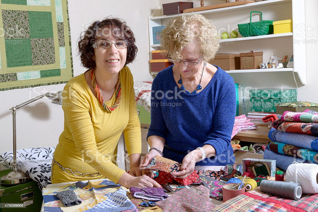 two women working on their patchwork stock photo