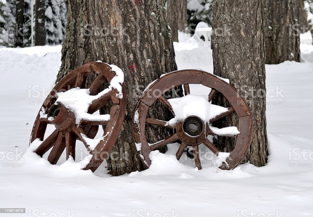 two wood wheel in the snow royalty-free stock photo