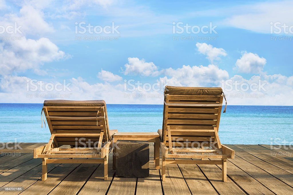 Two wooden beach chair royalty-free stock photo