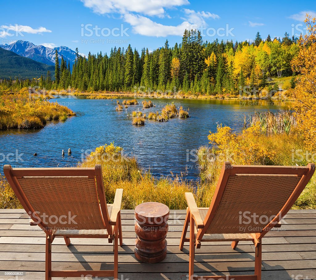 Two wooden chaise lounges stock photo