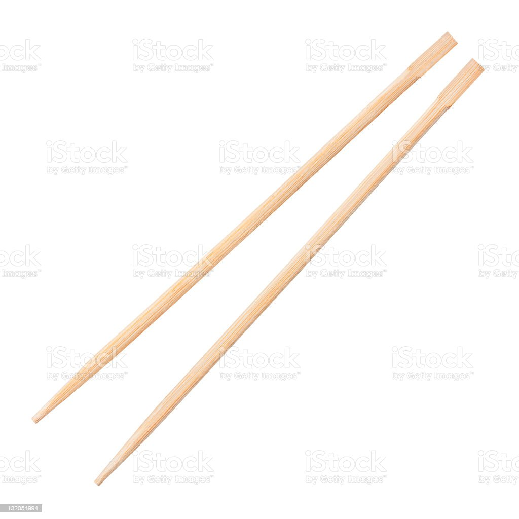 Two wooden chopsticks isolated against a white background stock photo