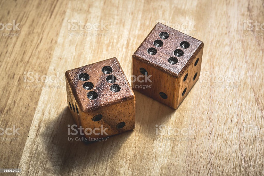 Two wooden dice with the number 6 on a table. stock photo