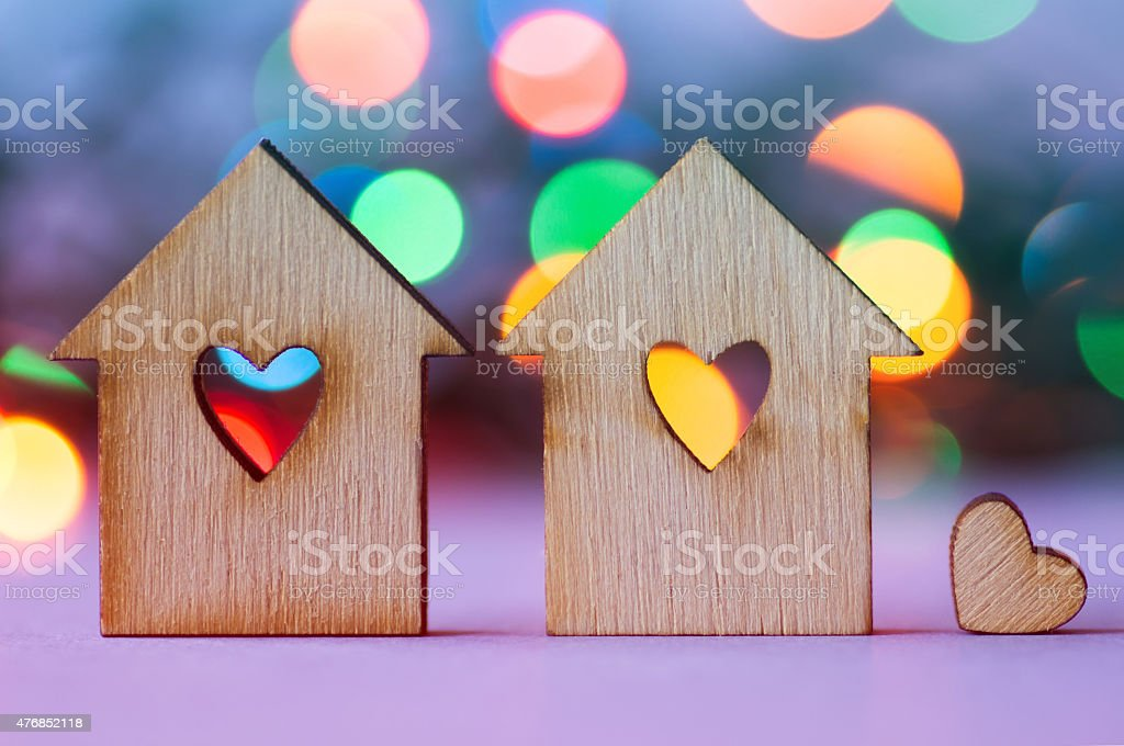 Two wooden houses with hole in the form of heart stock photo