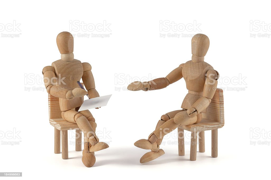 Two wooden mannequin placed as if having a conversation stock photo