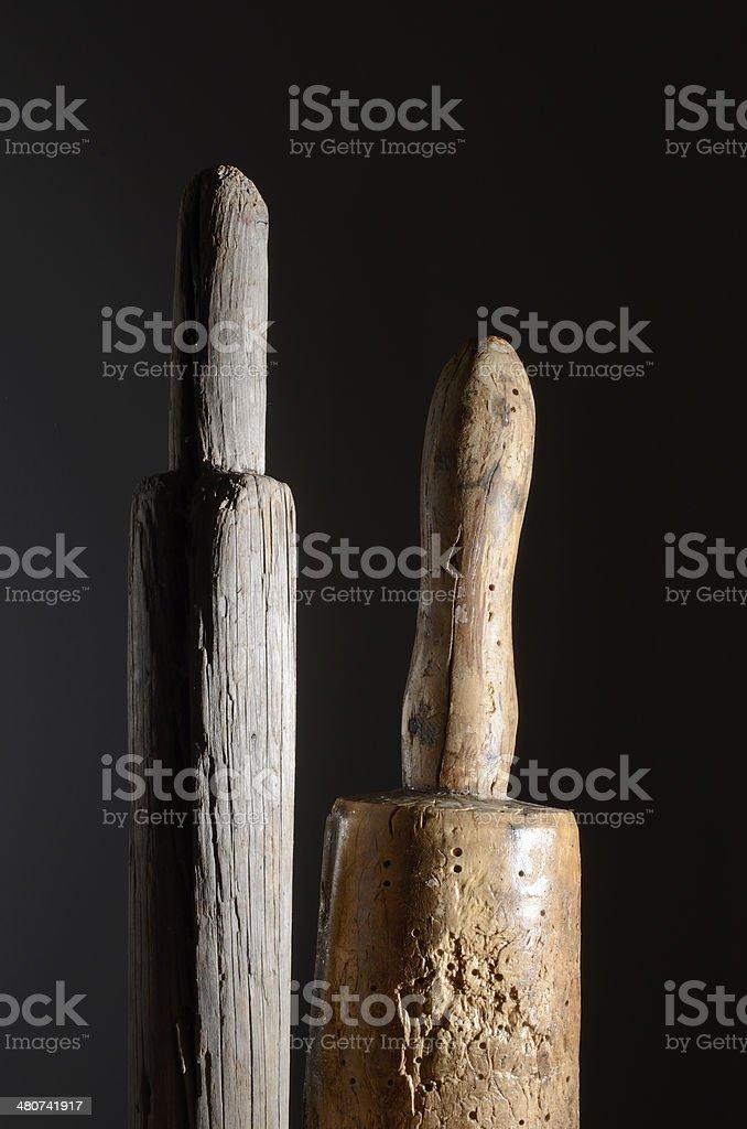 two wooden phallic object stock photo