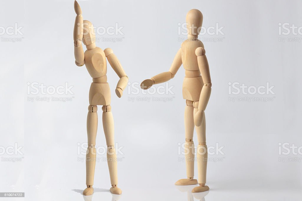 two wooden puppets stock photo