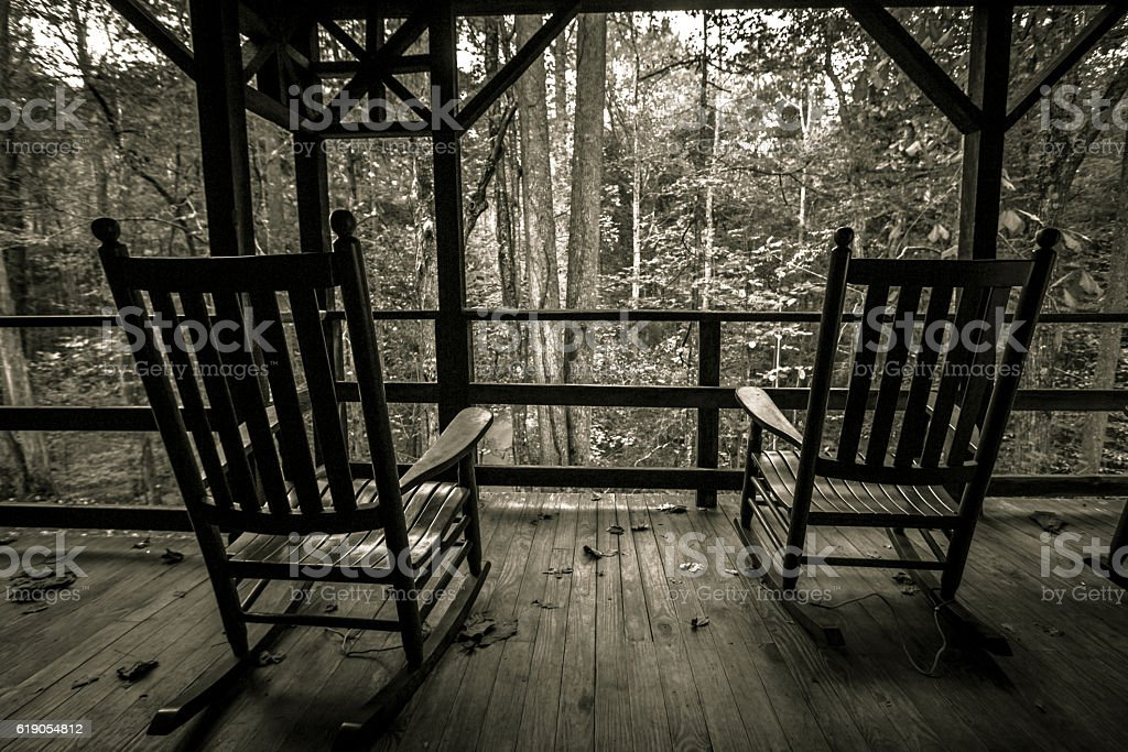 Two Wooden Rocking Chairs On Front Porch stock photo
