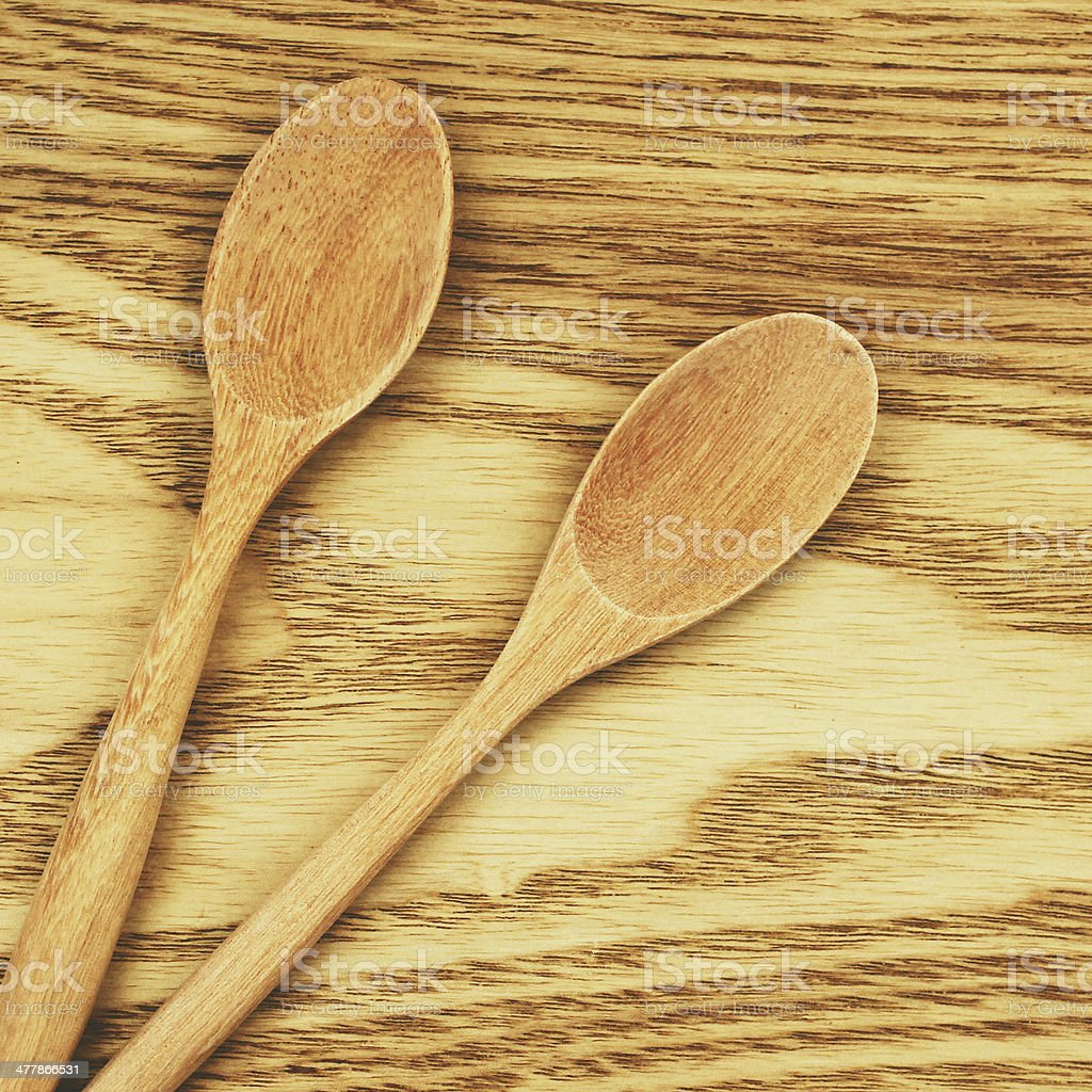 Two wooden spoons on table with retro filter effect stock photo