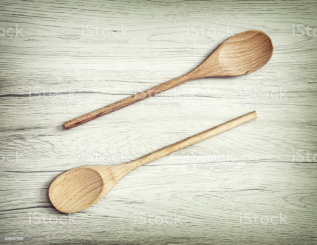 Two wooden spoons on the white background, kitchen equipment stock photo