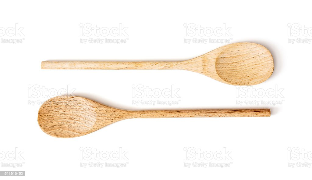 Two wooden spoons on the white background stock photo