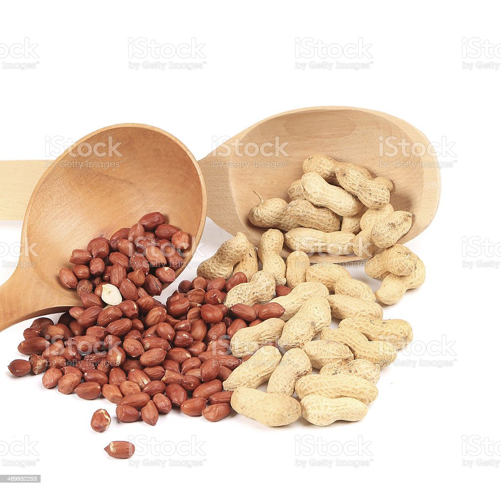 Two wooden spoons with peanuts royalty-free stock photo