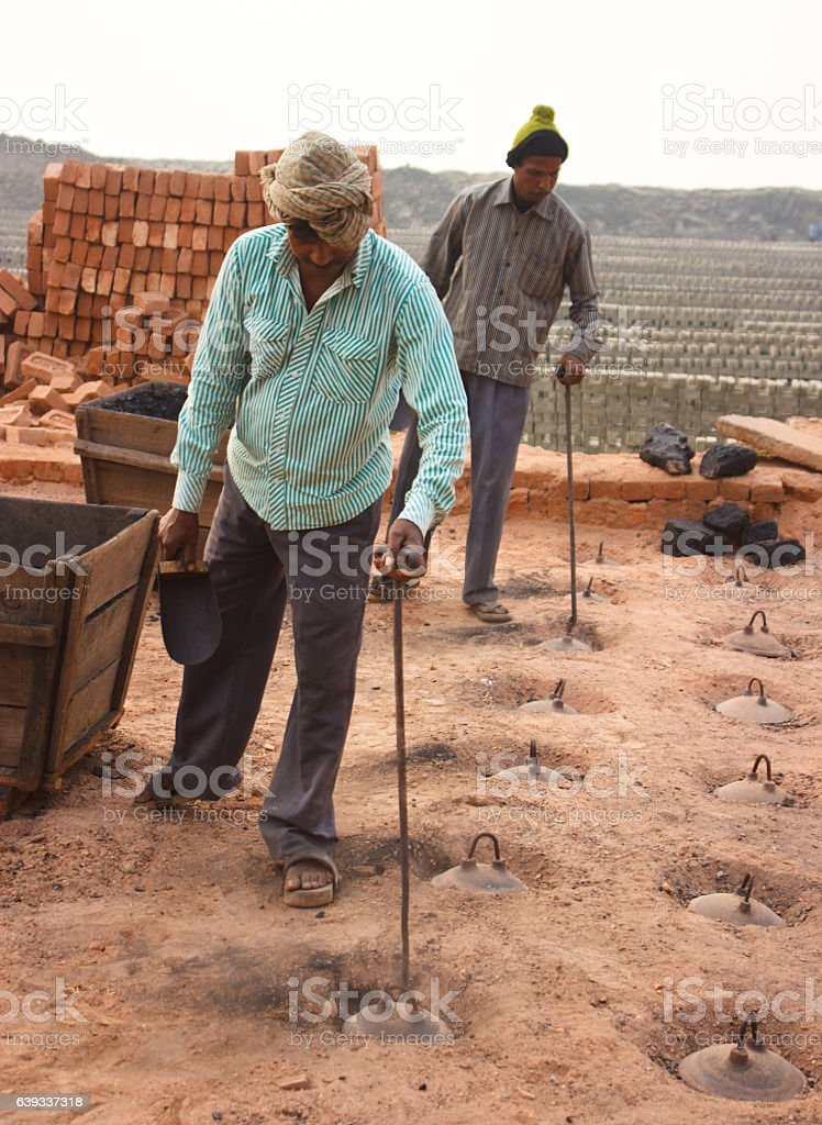 Two worker work at a brick factory stock photo
