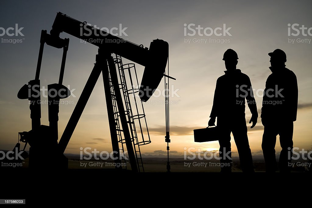 Two Workers and an Oil Derrick royalty-free stock photo