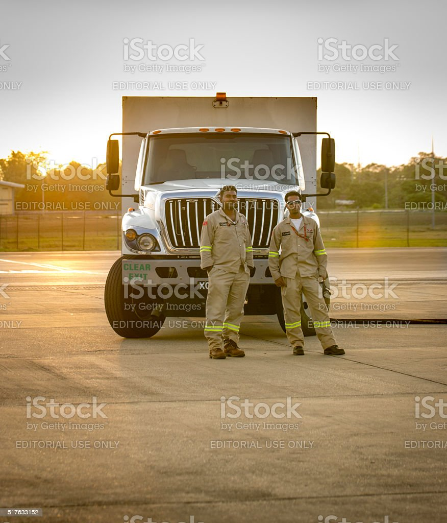Two workers and NP airport fuel truck royalty-free stock photo