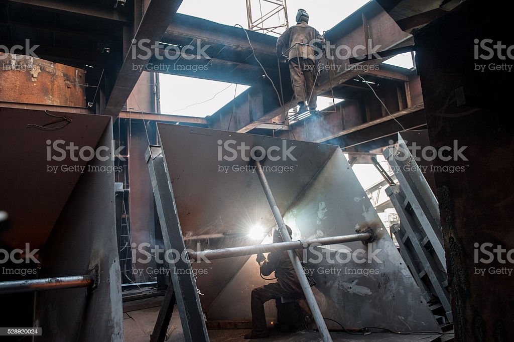 Two workers doing a industrial welding stock photo