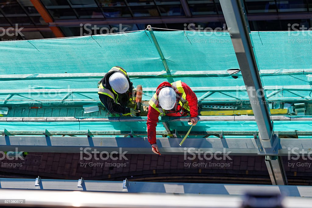 two workers on construction site stock photo