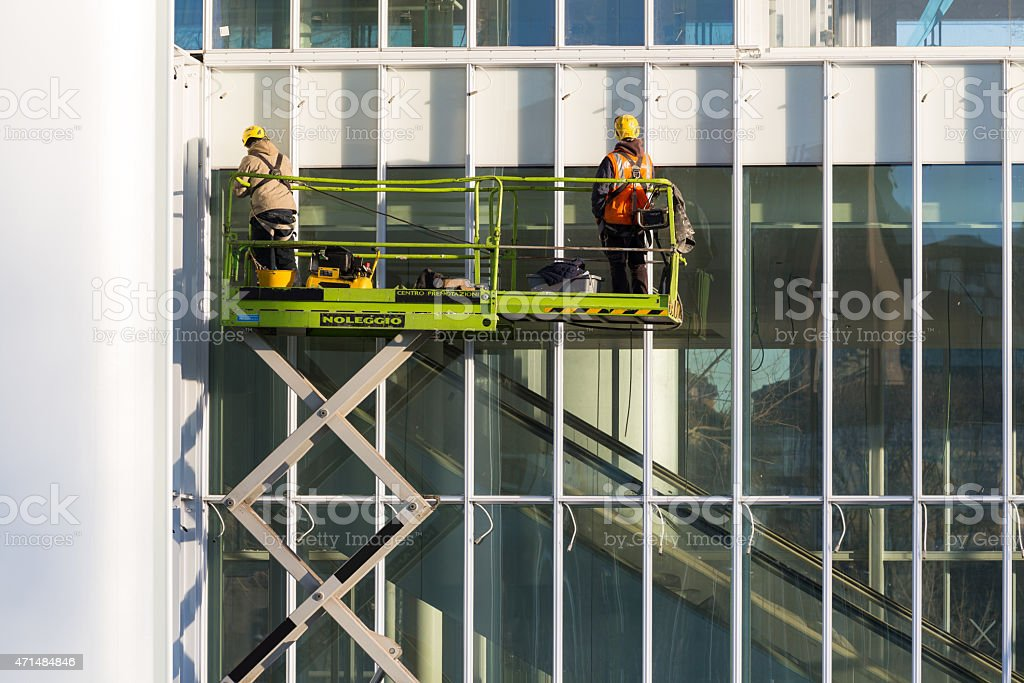 two Workers repairing at a building stock photo